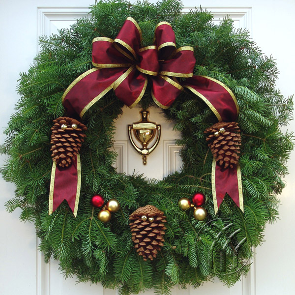 The elegant gold trimmed, wired satin bow has 7 lavish loops with long tails. The large pine cones laced with gold jingle bells and the bulb sets add to the stylish look of these most popular Holiday Evergreens.