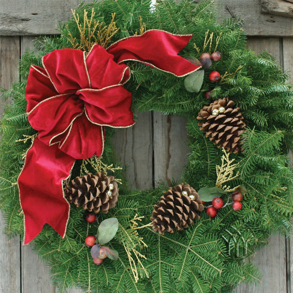 The elegant gold trimmed, wired fabric bow centerpieces this lovely wreath as a truly stunning Holiday Decoration. The faux cranberry picks and large pine cones laced with gold jingle bellscomplete the exquisite look of this popular Christmas Wreath and Door Spray!