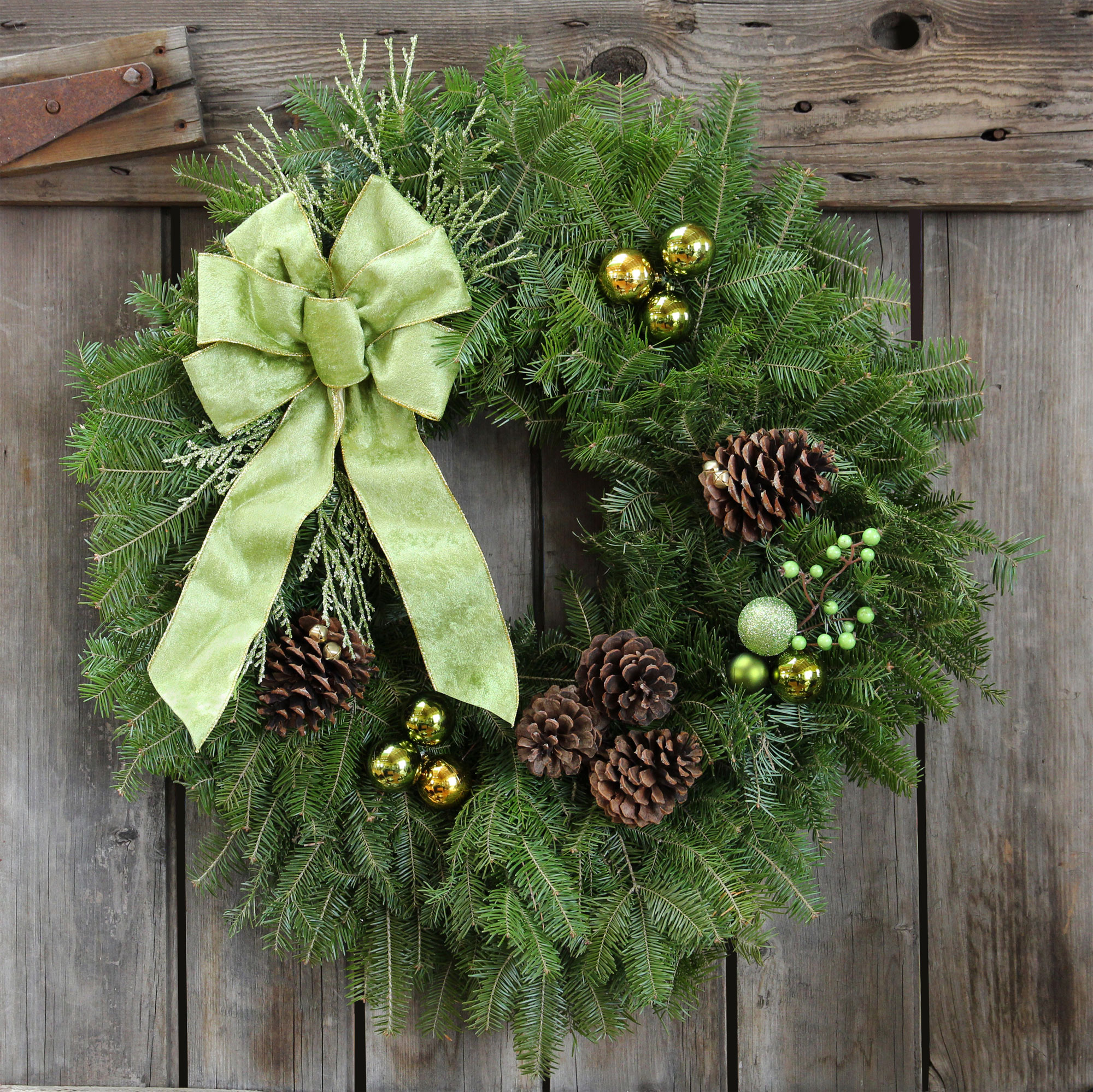 The truly unique look of these Holiday Evergreens will stand out in any neighborhood! The stylish green bow and trimmings are accented with bronzed cones laced with gold jingle bells.