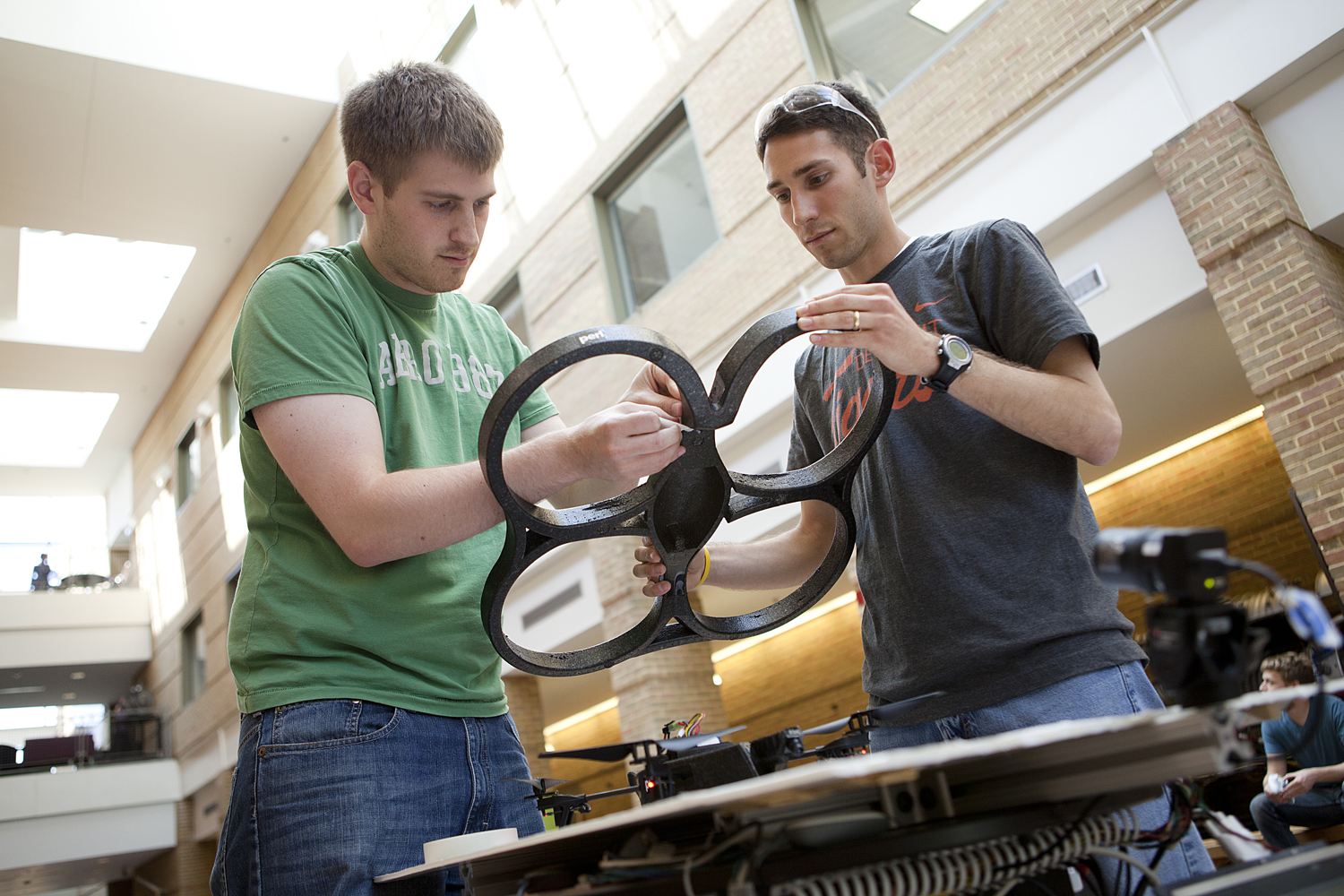 Noah Katzman, Stephan Chaves, Ryan Wolcott, and Nick Carlevaris-Bianco test autonomous quadrotor landings in the François-Xavier Bagnoud Building on the University of Michigan's North Campus.    The quadrotor, using its on-board camera, locates the moving Segway and automatically lands on it. This is done to simulate the autonomous landing of a flying vehicle on the deck of a Navy ship.    The Navy, through the Naval Engineering Education Center program, is looking to educate and hire students who are trained in the science and technology behind the next-generation of autonomous systems. This projects gives students hands-on experience with real robotic systems.