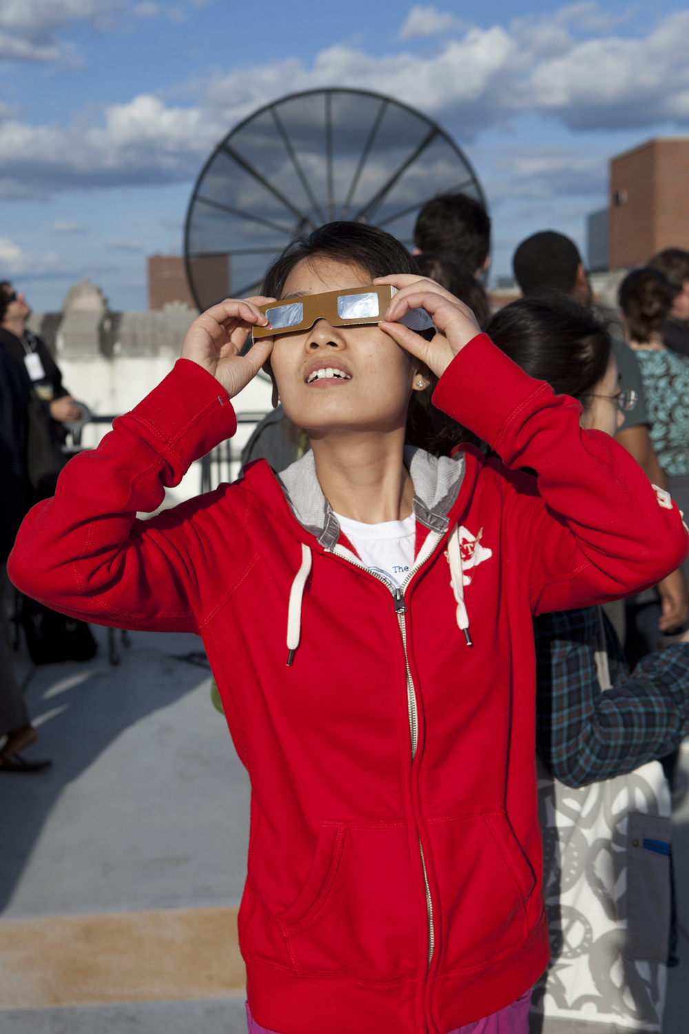 Fei He views the  Transit of Venus  with special glasses at the University of Michigan's Angell Hall in Ann Arbor, Michigan. June 5, 2012