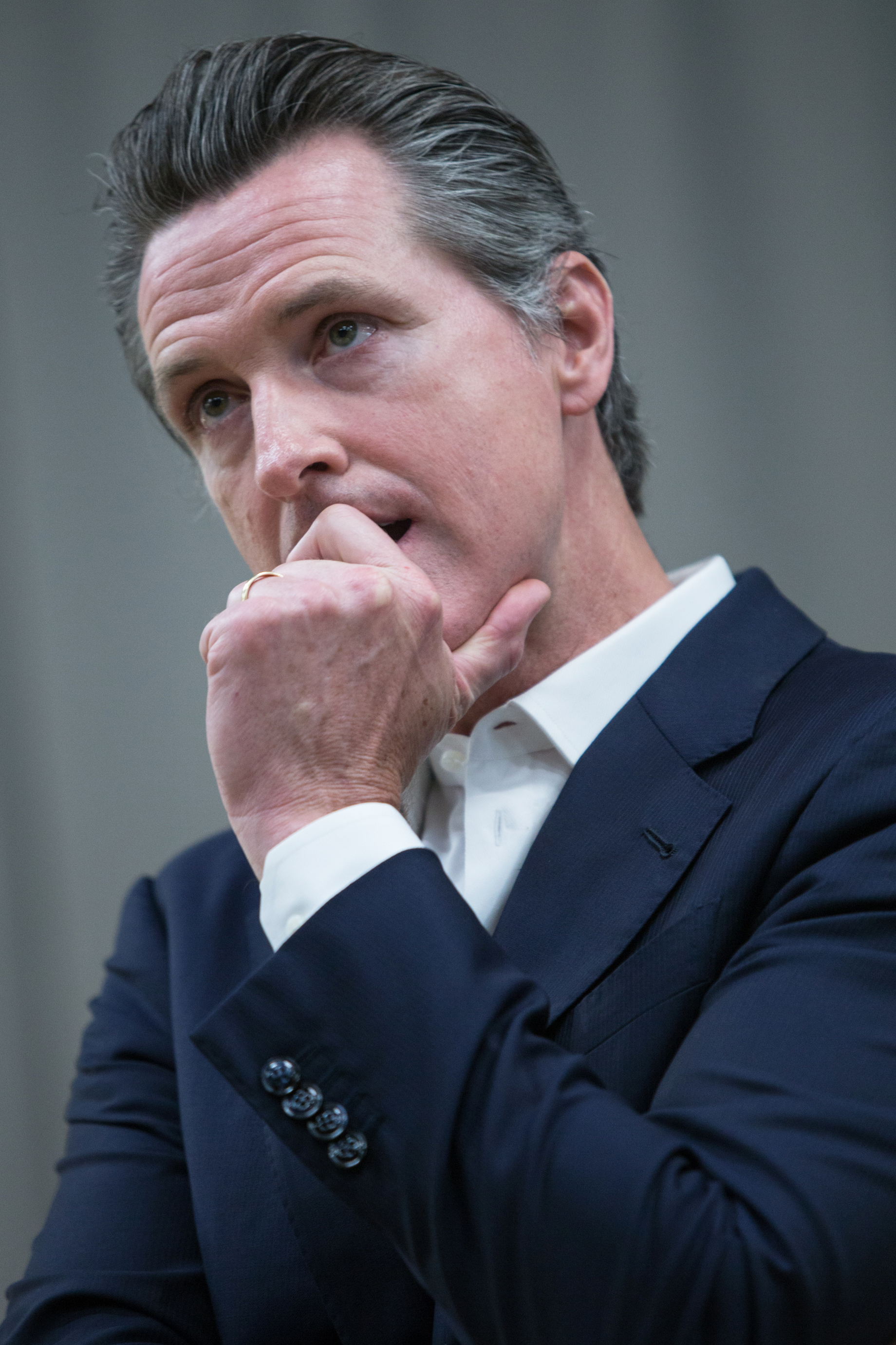 California Governor Gavin Newsom listening to a question from the audience