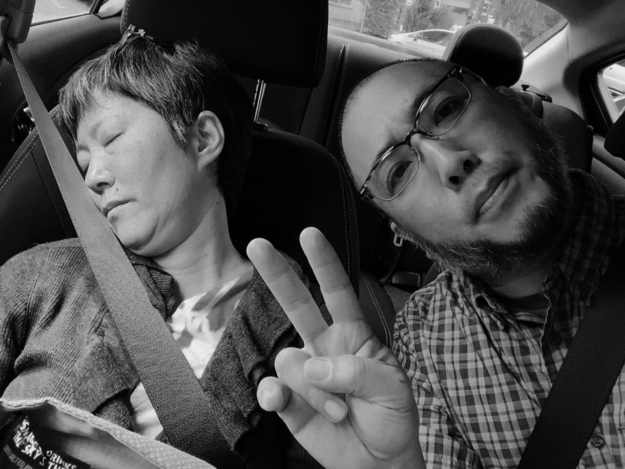 Within 10 minutes of arriving in Seattle and picking up our rental car Hayashi was already asleep.  Photo by Shishido.