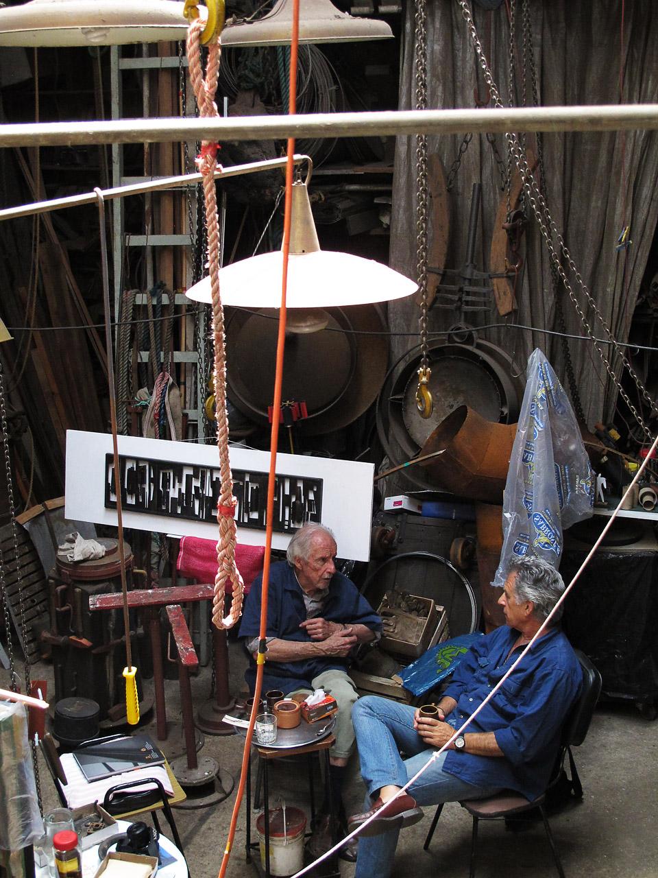 sculptor, montevideo, uruquai •  octavio podestá  in his atelier talking with photographer  oscar bonilla