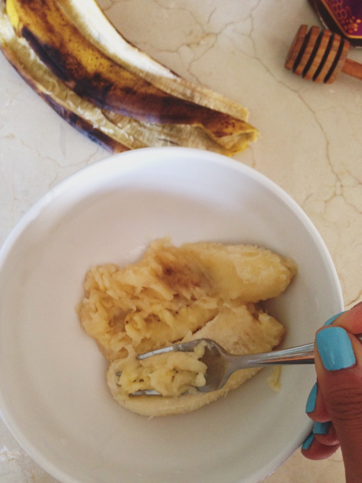 Peel overripe banana, place in mixing bowl and mash it up with fork.