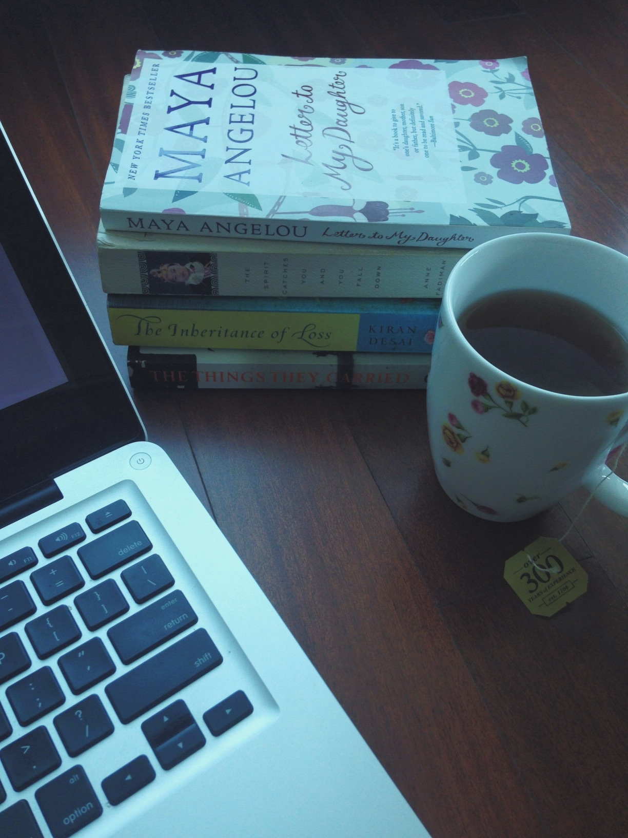My current view: laptop, our 4 picks, a cup of Earl Grey
