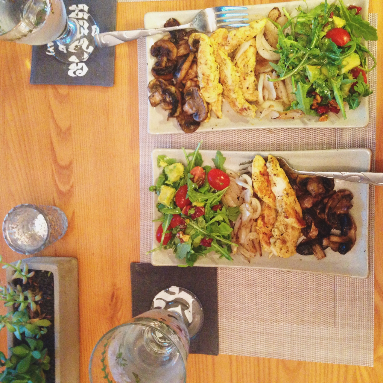A more elaborate dinner: Mustard-marinated chicken, grilled onions and mushrooms, arugula salad with tomatoes and avocado