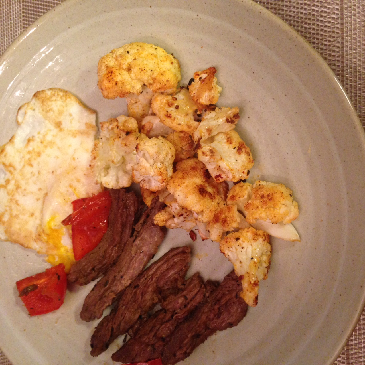 Dinner at home: skirt steak, eggs, grilled red peppers, roasted cauliflower