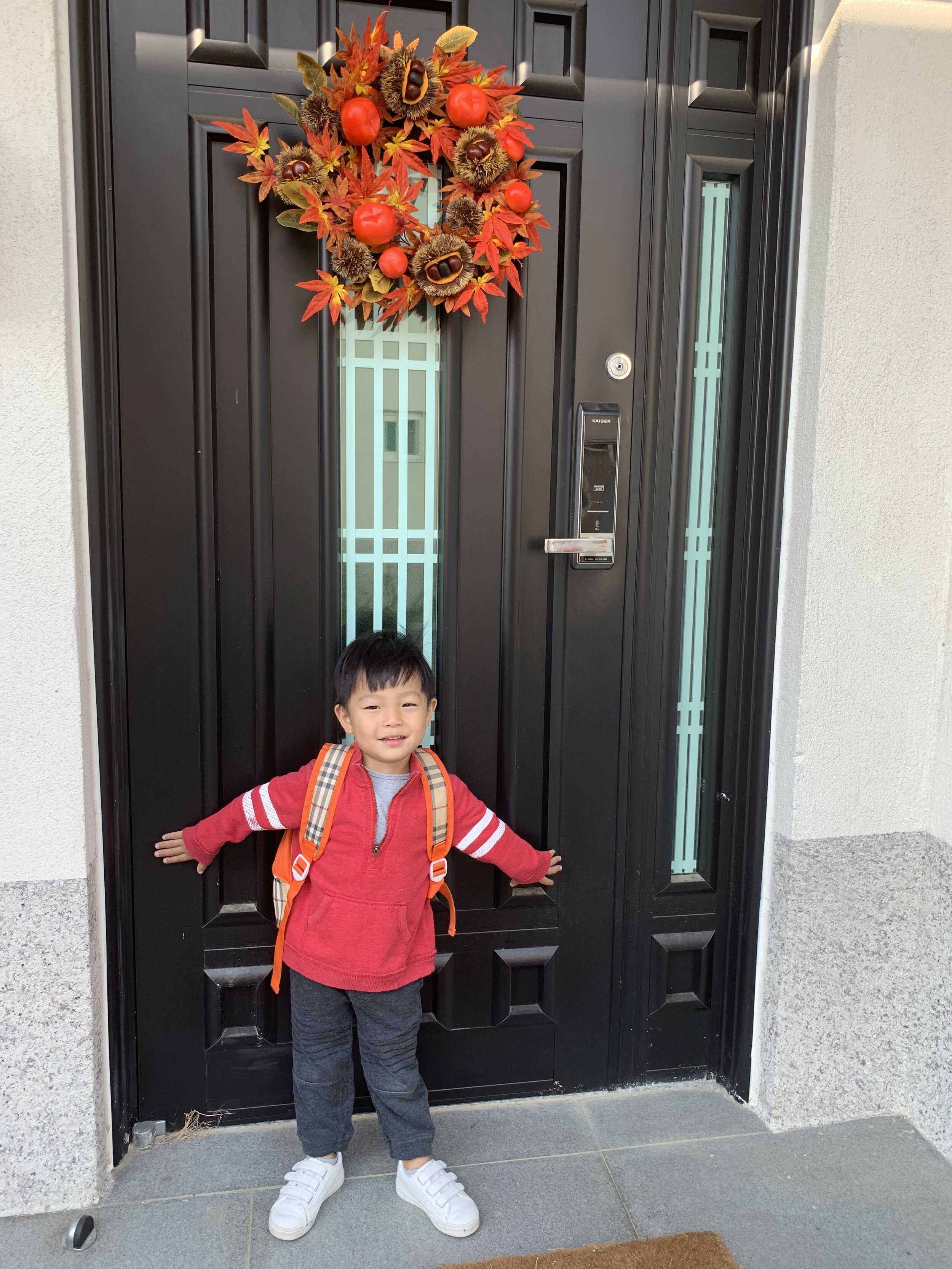 J in his newly thrifted outfit and our new fall wreath!