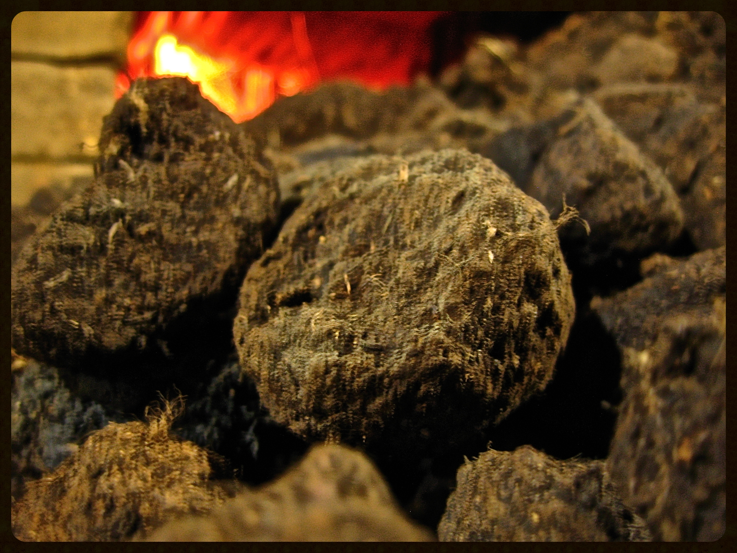 Dried peat going into the kiln.
