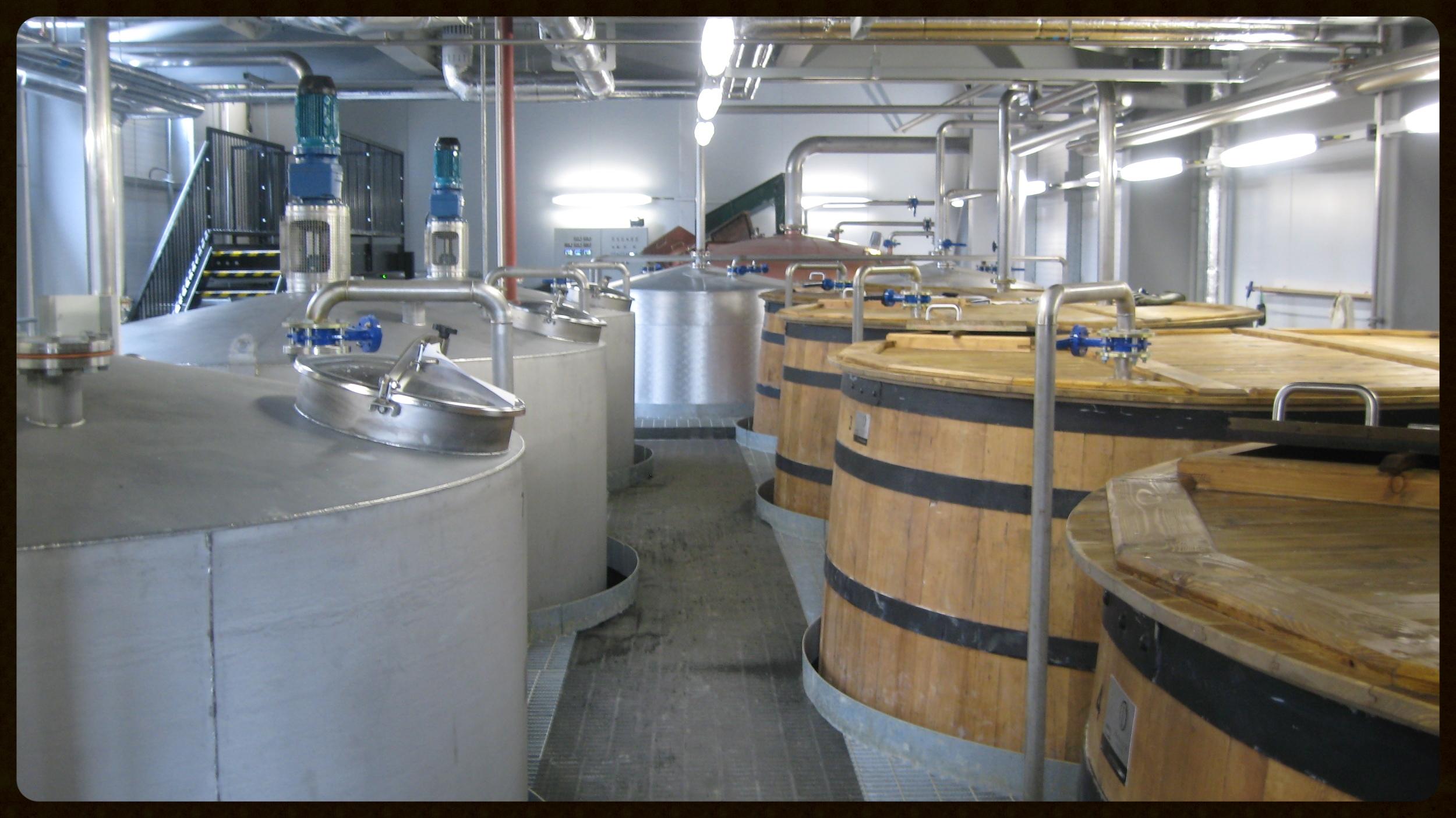 Steel mash tuns and wooden wash backs at Ardnamurchan Distillery, Scotland.