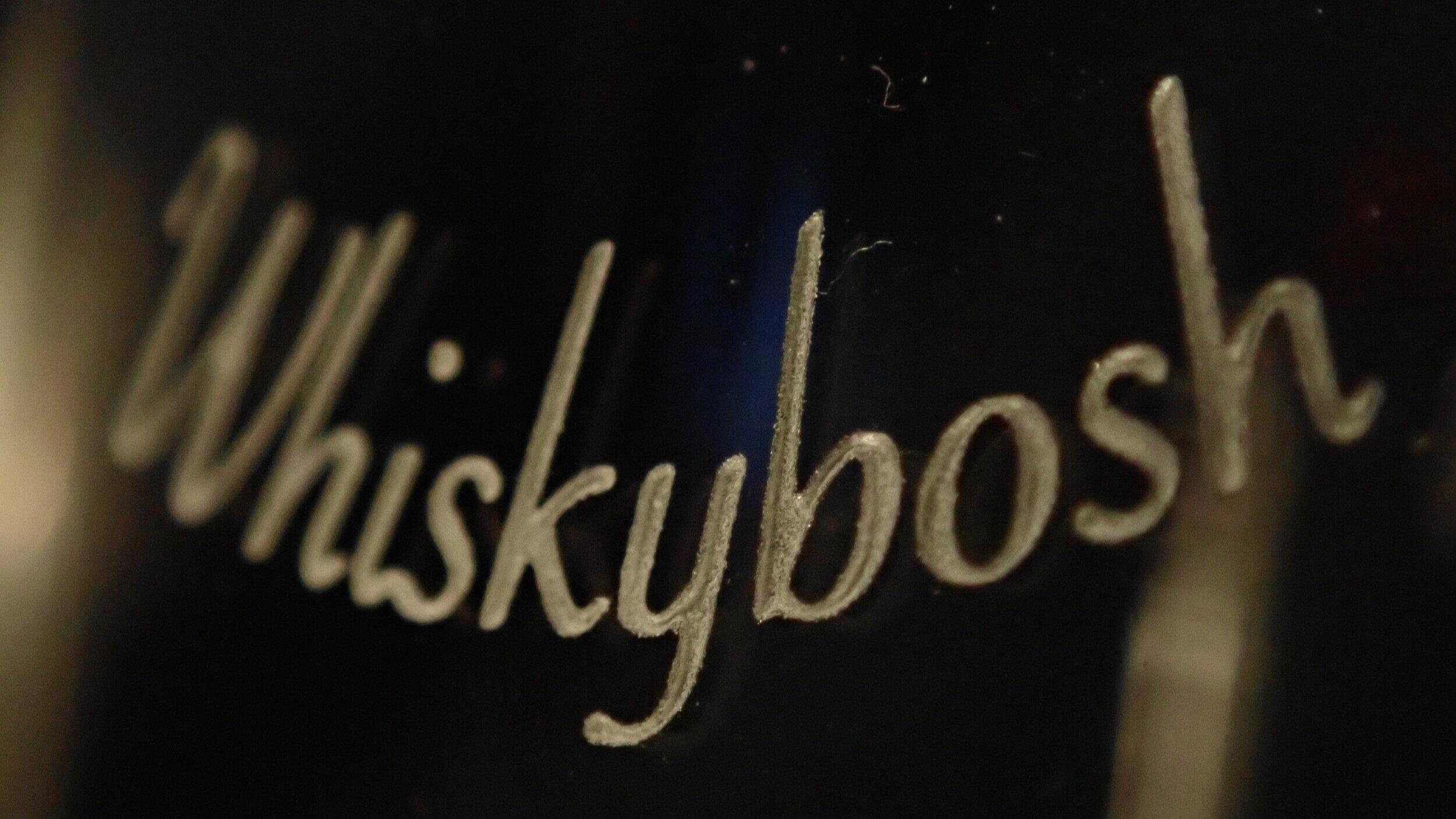 Engraved malt scotch whisky glass.
