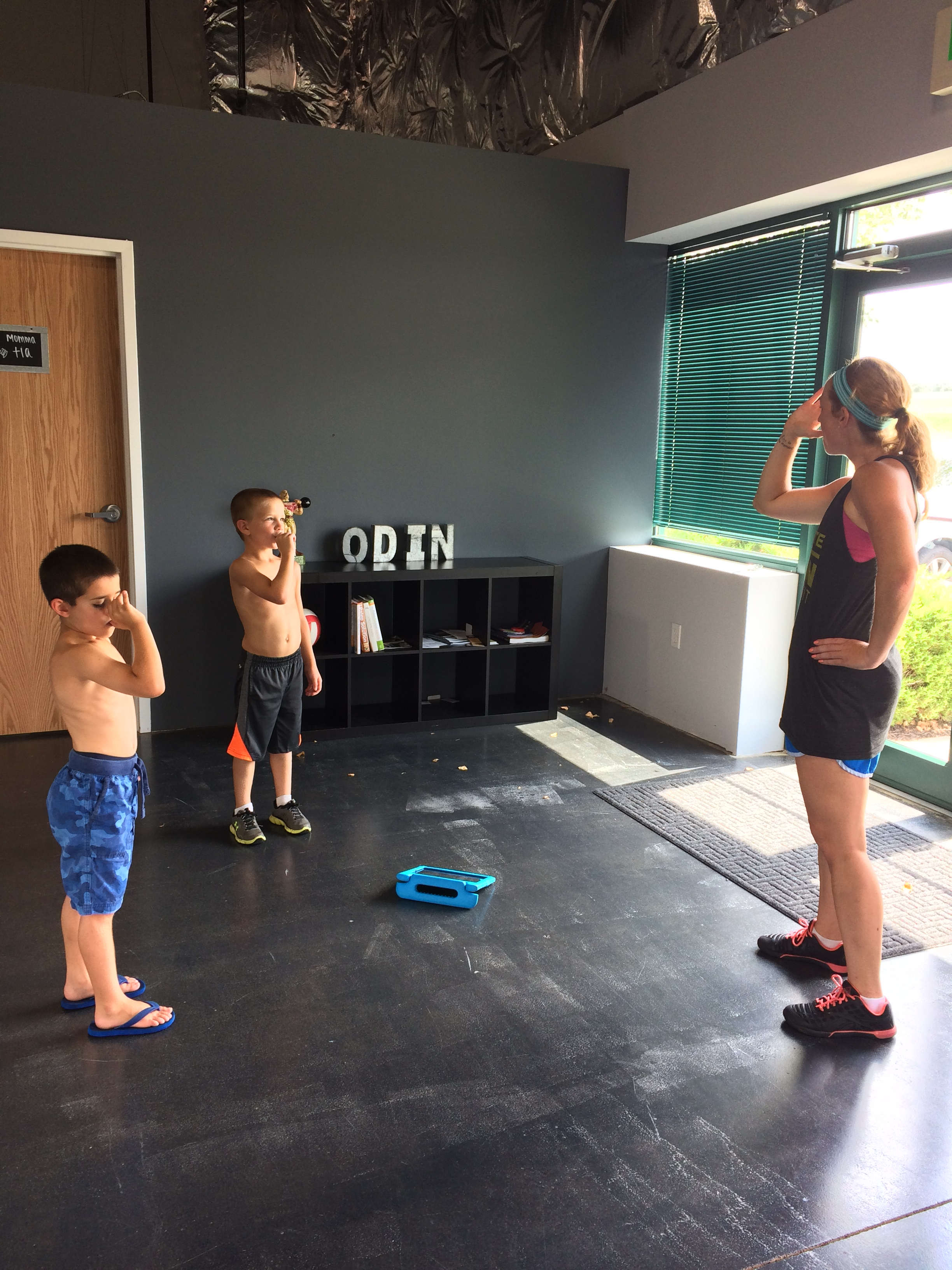 Coach Lisa is teaching the boys how to blow up their muscles. They were impressed!