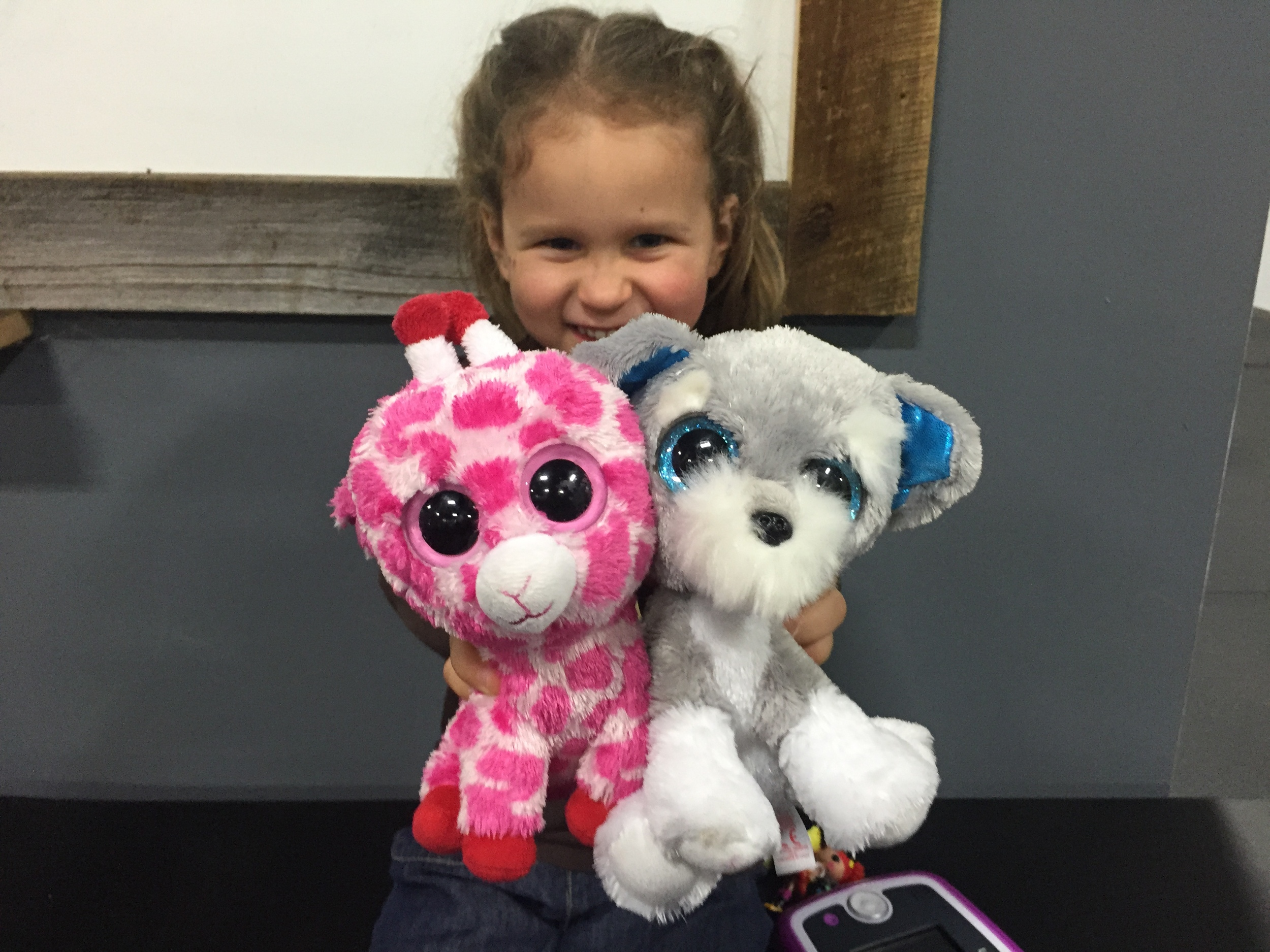 You can't be angry with Tia about this workout because...look at Hannah and her cute stuffed animals! Doesn't that make you forget about rowing and burpee pull ups? So cute!