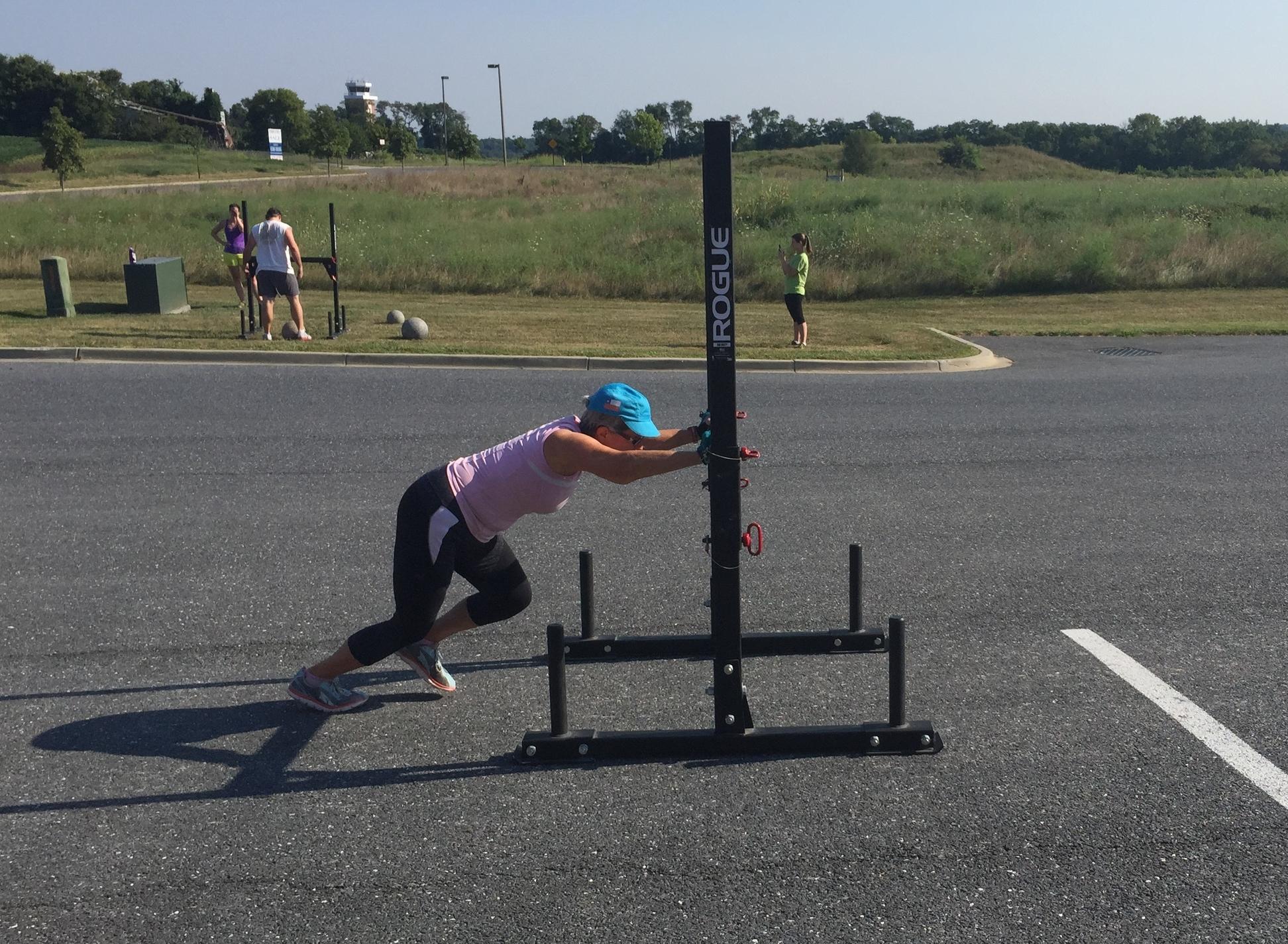 Margaret, pushing the prowler during a Strongman workout.