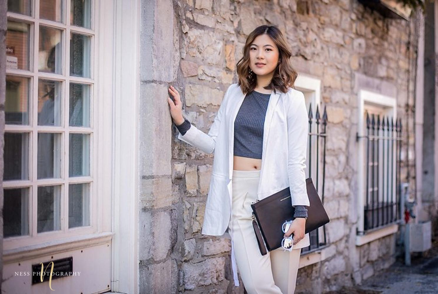 Heydahye portrait in front of old montreal brick walls and windows