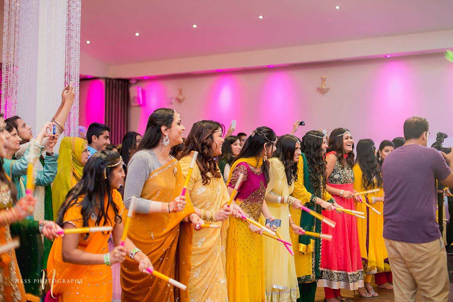 bridesmaids play dholdki in yellow at mehendi in ottawa