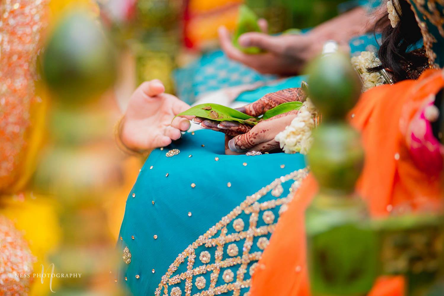 bride holding leaf with henna on it during pakistani mehendi in ottawa