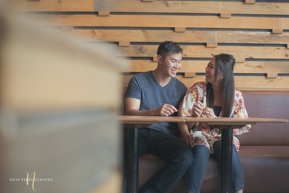 wide photo of asian couple sitting at cacao70