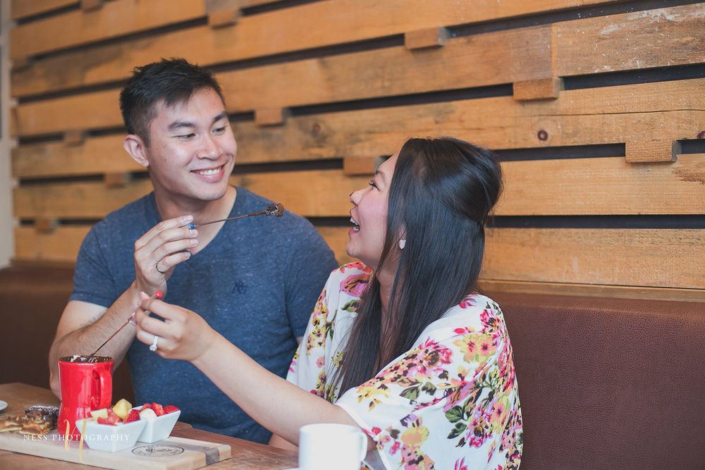 couple playing with chocolate on the face during cacao70 engagement photoshoot