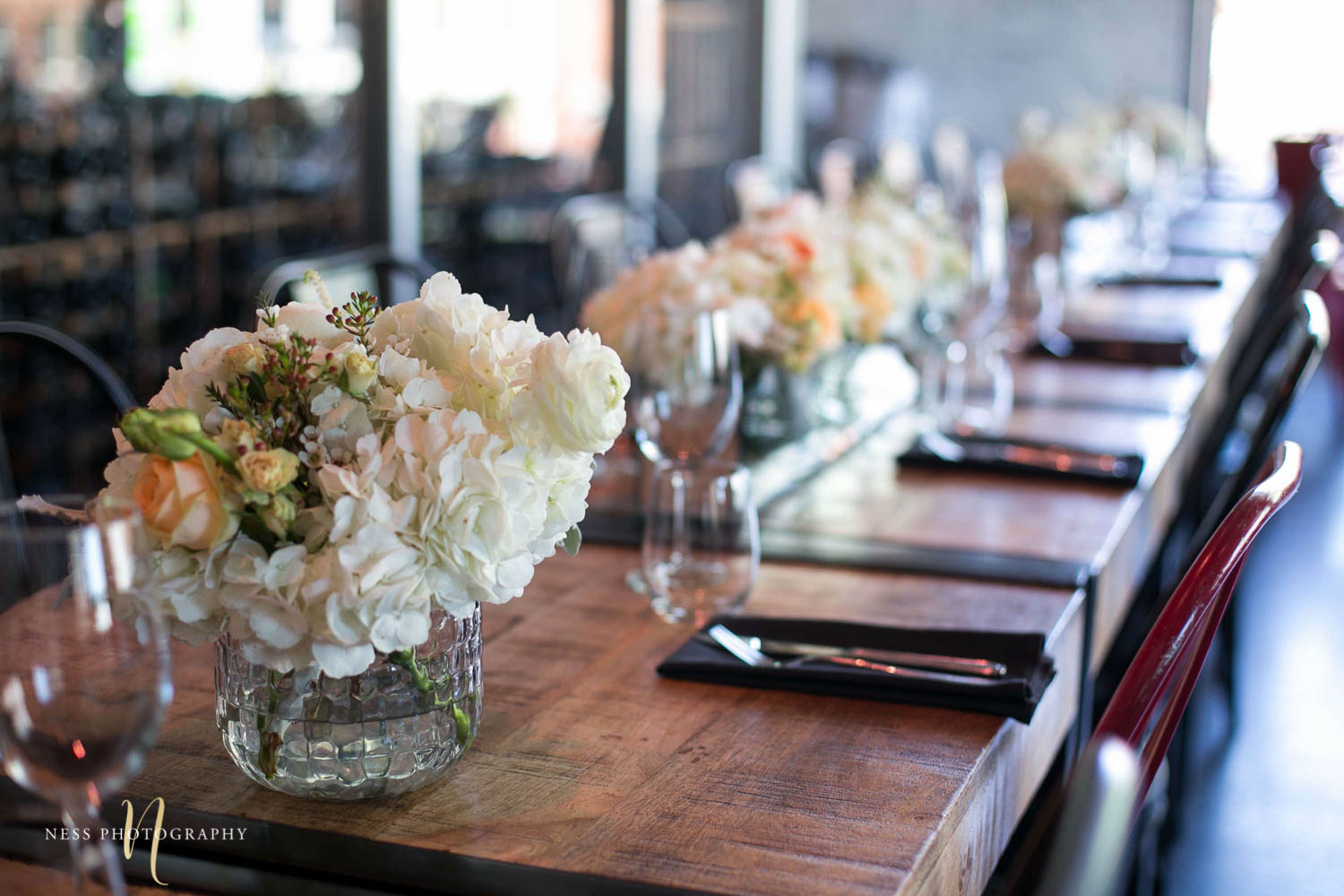 floral vases on the table and background blurry at engagement Party in Montreal