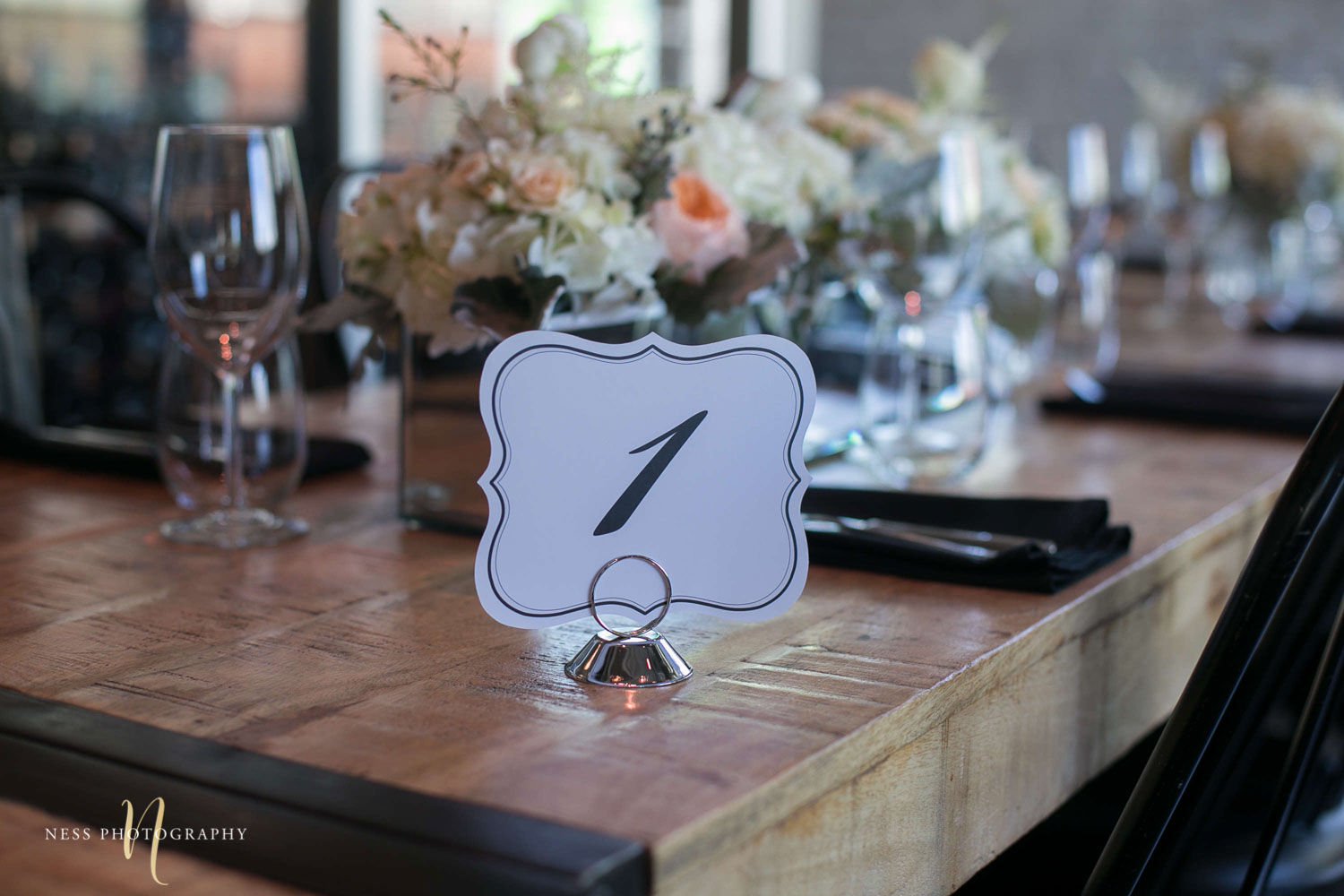 table numbers with flowers in the background at engagement Party in Montreal