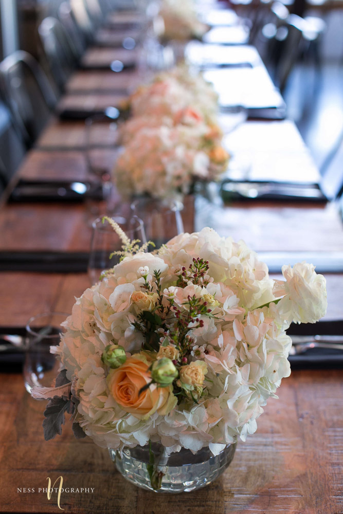 focus on floral vase and table behind at engagement Party in Montreal