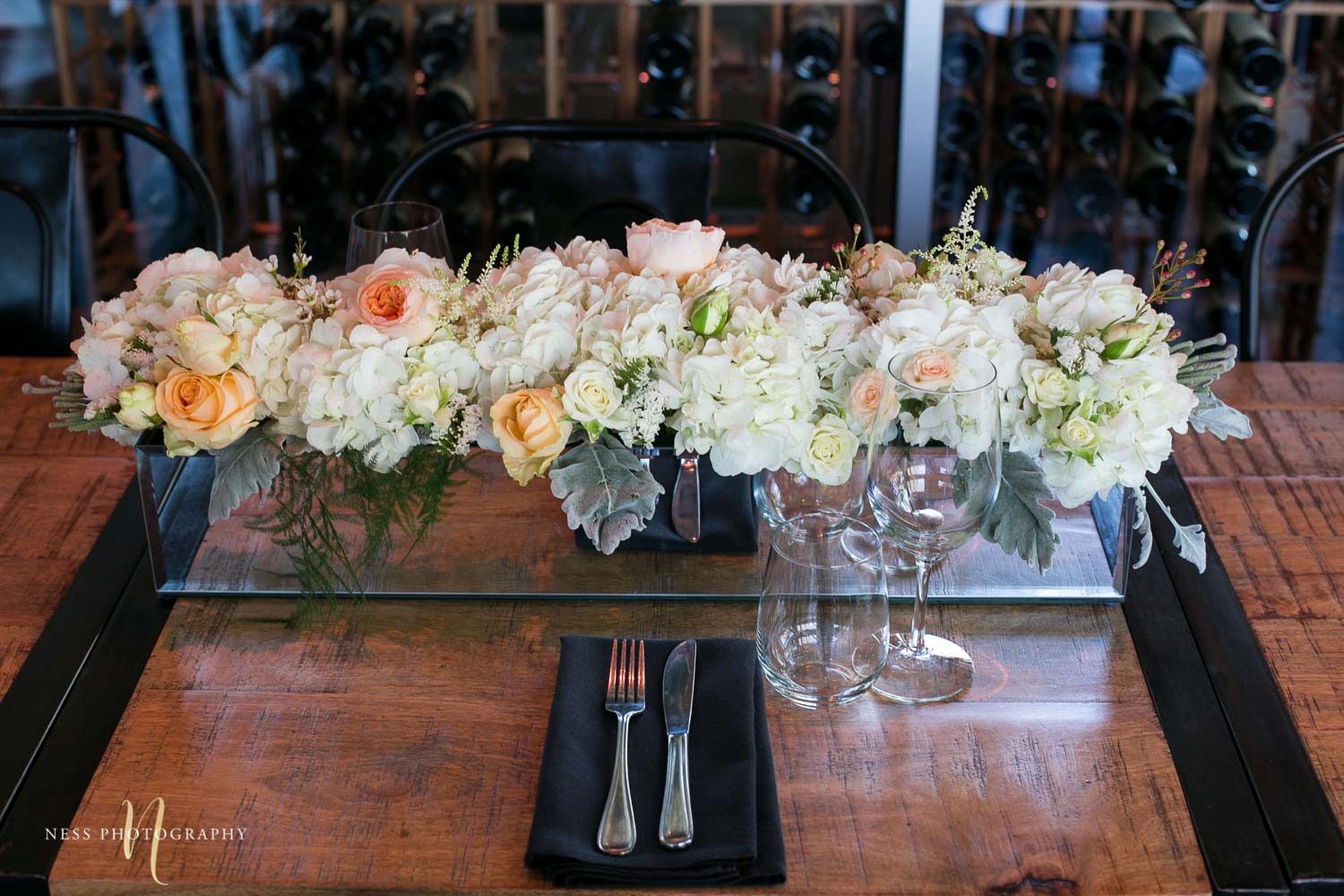 white flowers in mirrored vase at engagement Party in Montreal