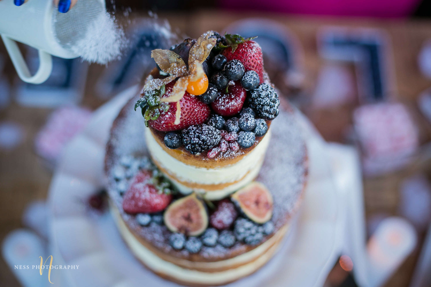 powder sugar sprinkled over fruit naked cake by rustique pie at engagement Party in Montreal