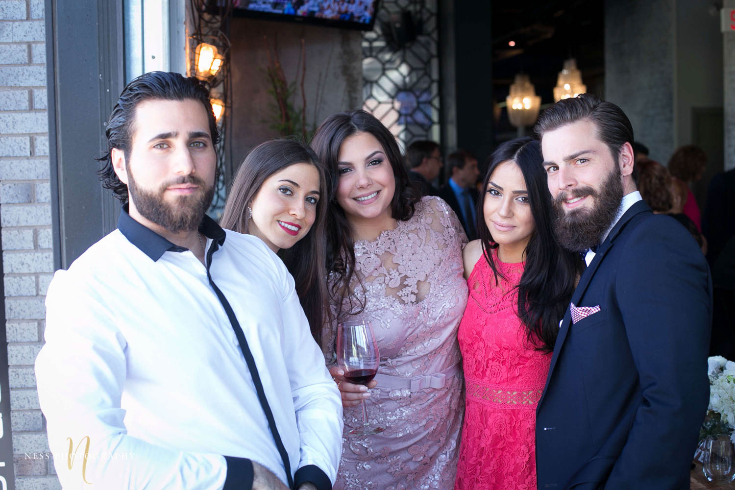 bride to be surrounded by guests for group photo at engagement Party in Montreal