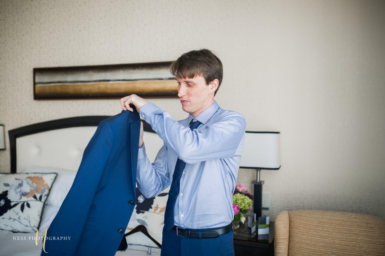 montreal elopement groom putting his jacket on