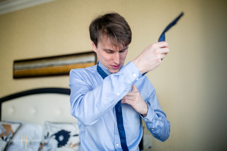 montreal elopement groom putting on his tie