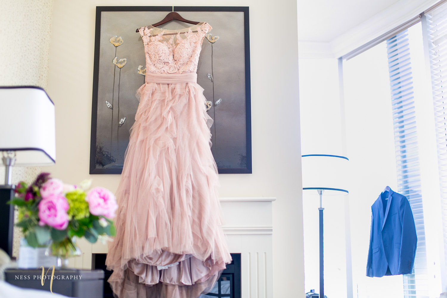 mmontreal elopement bride dress and groom jacket hanging side by side
