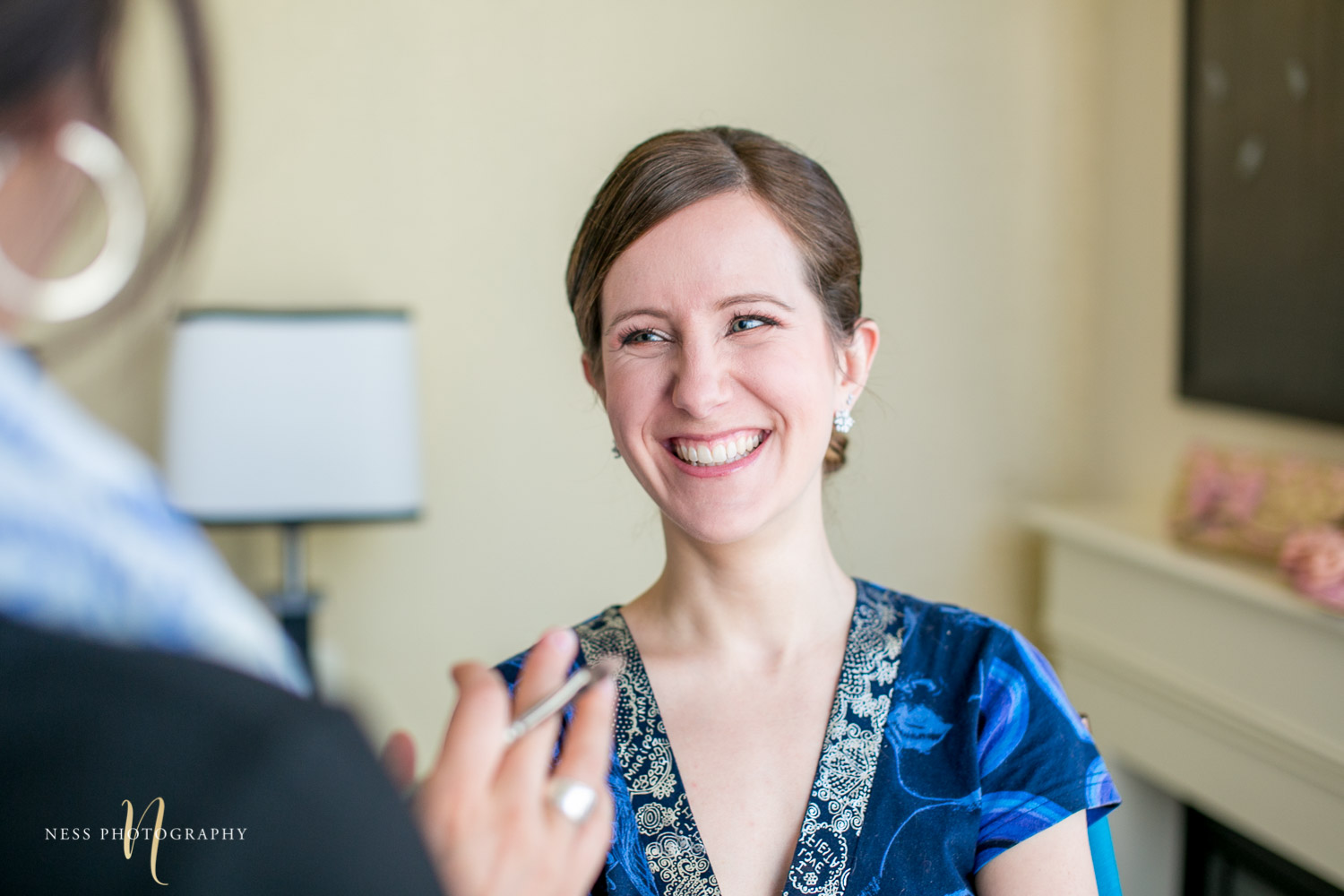 bride getting her makeup done for montreal elopement