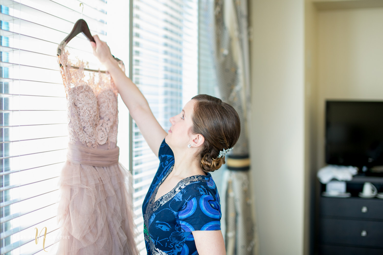bride picking up her blush dress for montreal elopement