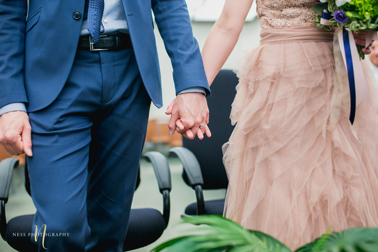 bride and groom holding hands during Montreal elopement at palais de justice