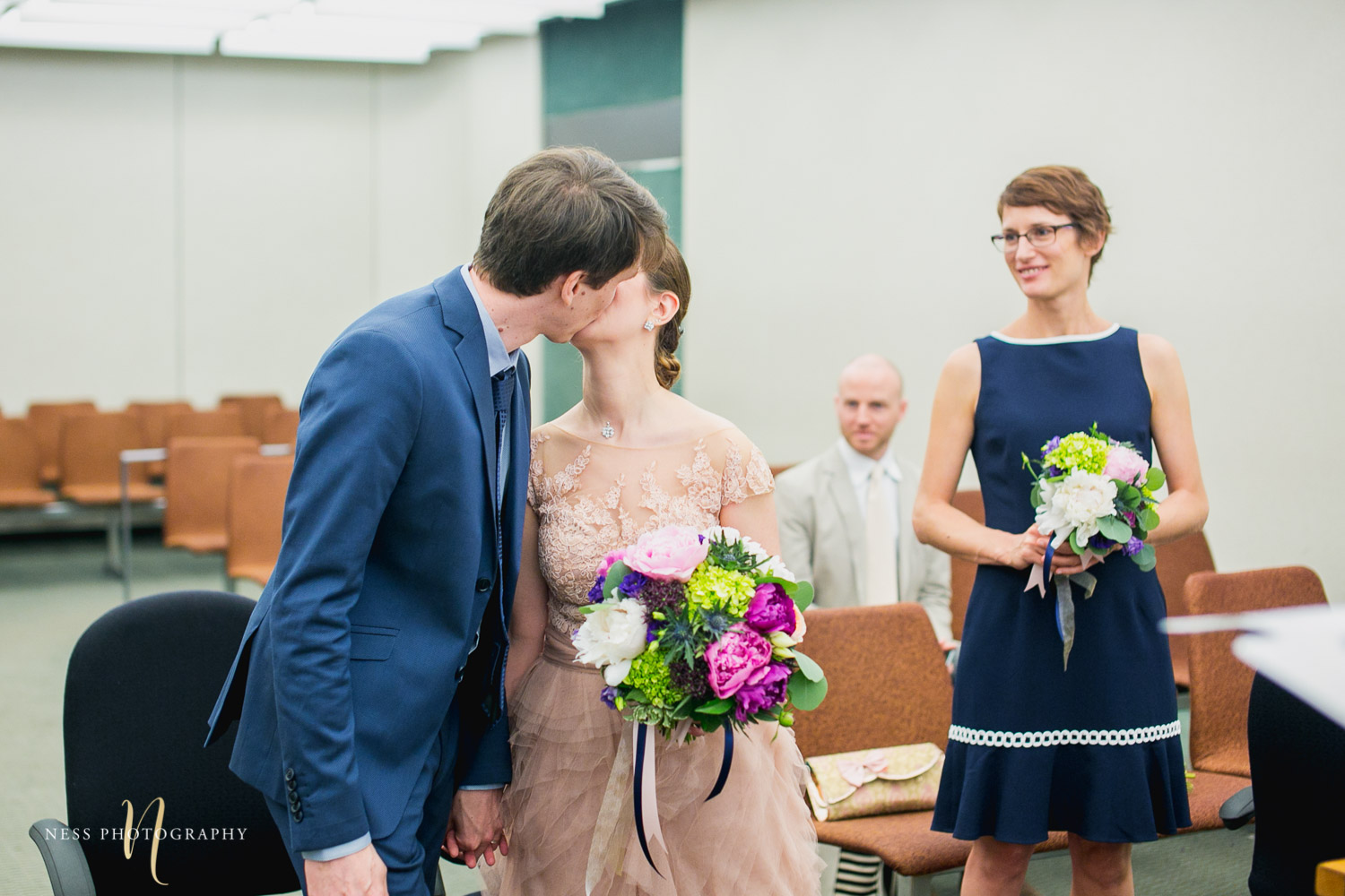 bride and groom first kiss during Montreal elopement at palais de justice