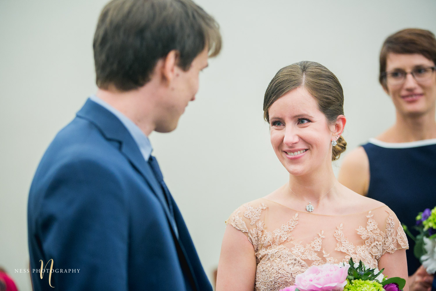 bride looking at groom during Montreal elopement at palais de justice