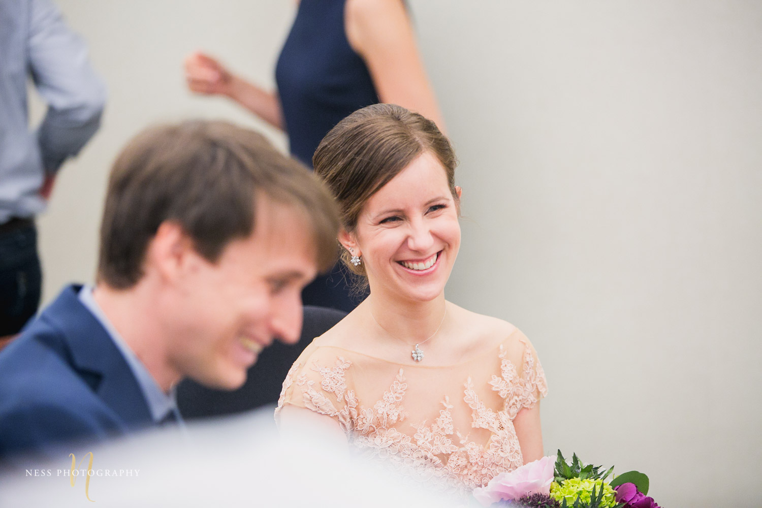 bride laughing during Montreal elopement at palais de justice