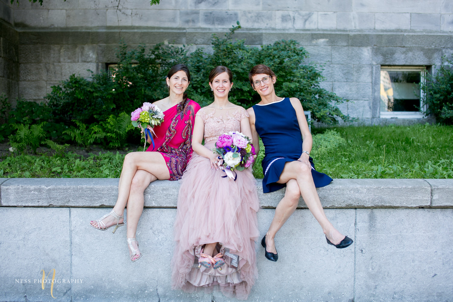 bridesmaids sitting during montreal elopement in old port