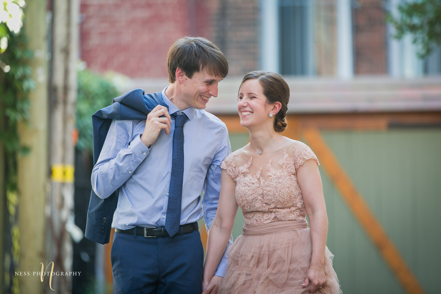 bride and groom walking and laughing during elopement wedding photos in plateau mont royal