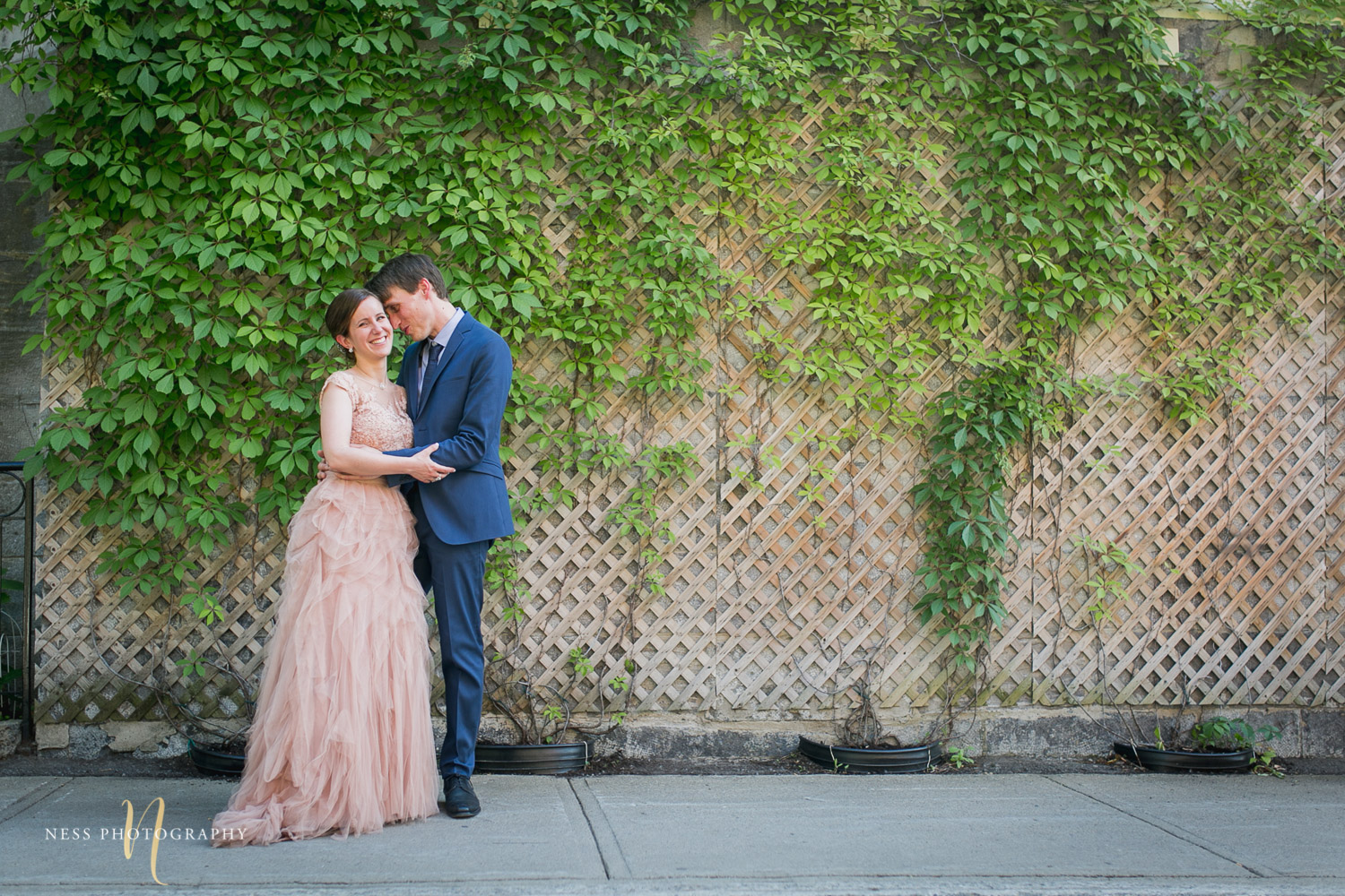 bride and groom in front of vines in plateau mont royal for elopement photos