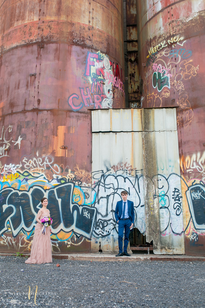 bride and groom in front of graffiti wall in canal lachine for their montreal elopement