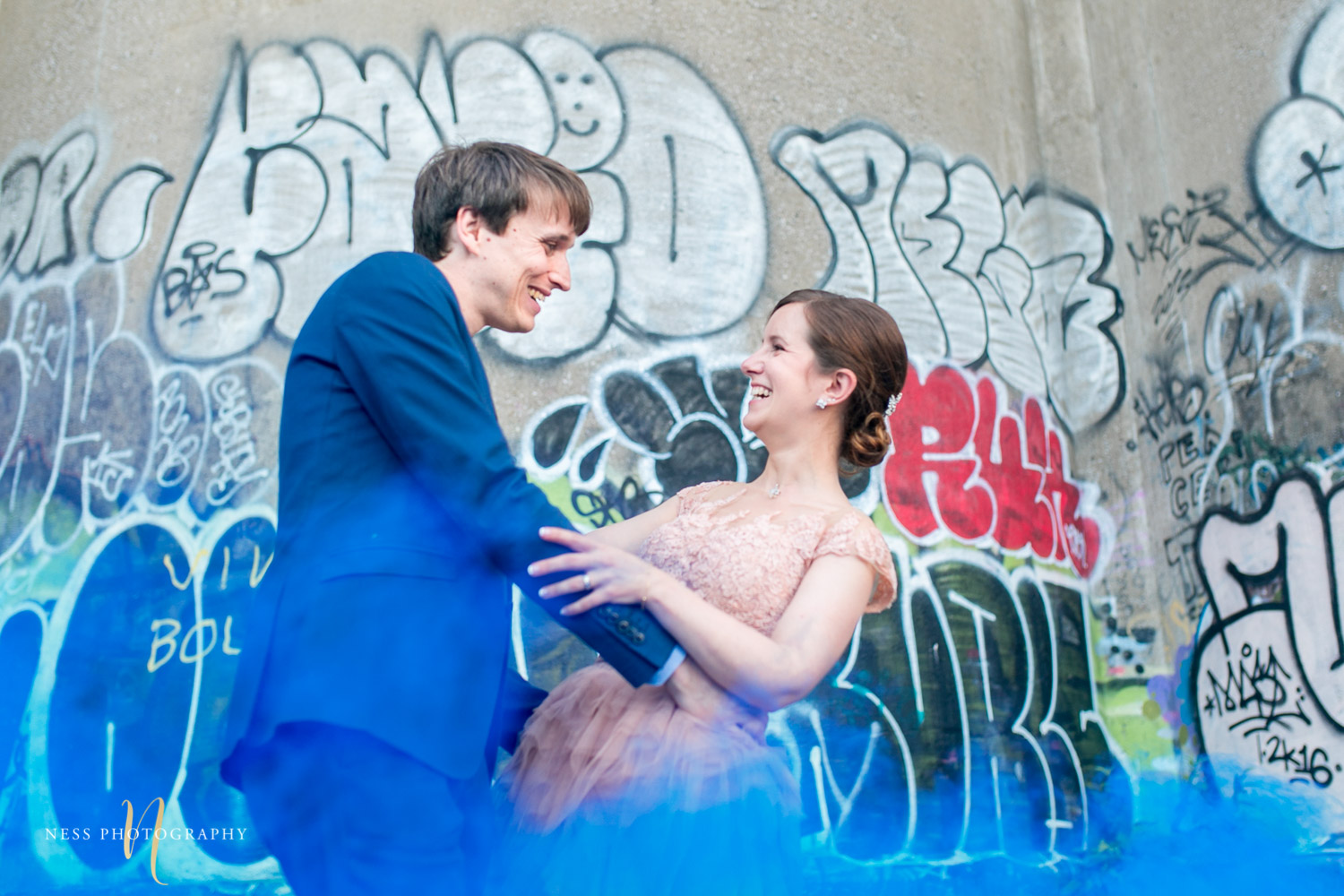 bride and groom dancing in bleu smoke bomb in canal lachine for their montreal elopement