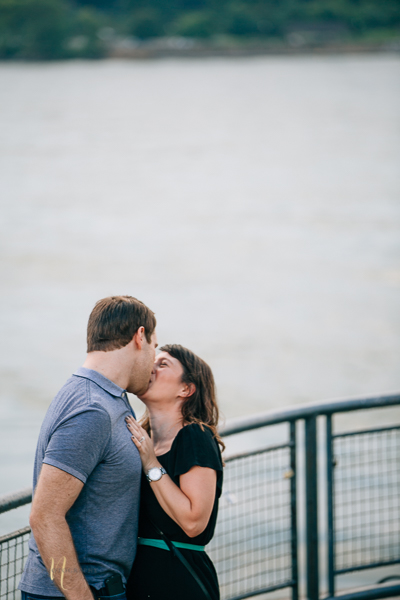 couple kissing after surprise proposal in old montreal