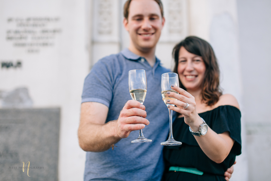 Surprise proposal  with champagne in montreal old port clock tower by ness photography montreal wedding photographer  3.jpg
