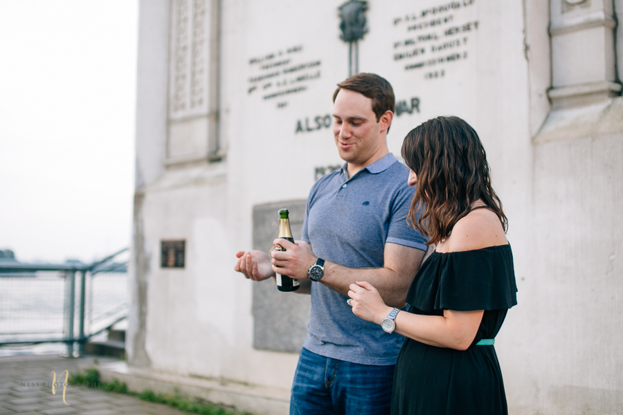 Surprise proposal  with champagne in montreal old port clock tower by ness photography montreal wedding photographer .jpg