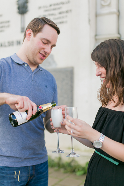 couple drinking champagne after surprise proposal in old montreal clock tower pier