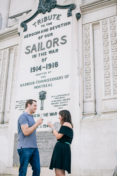 Surprise proposal  with champagne in montreal old port clock tower by ness photography montreal wedding photographer  4.jpg