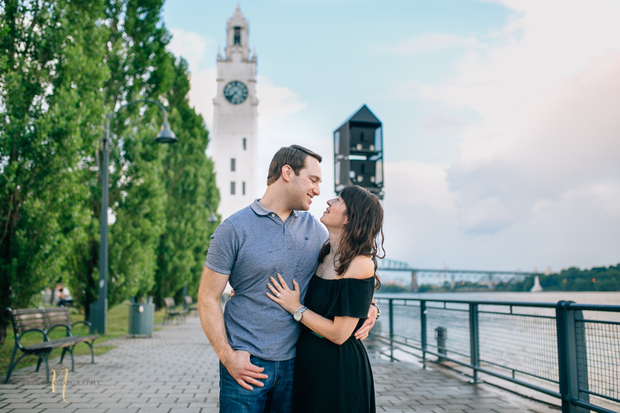 just engaged couple in montreal old port in front of clock tower
